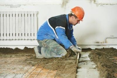 A construction man levelling Bundaberg Concreters concrete